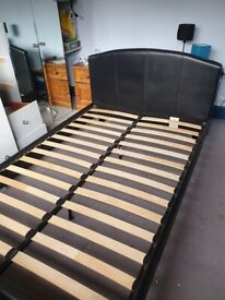 Small double black pleather bed frame.