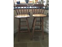 A pair of high backed kitchen stools - light wood,good condition