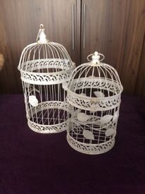 White metal birdcages