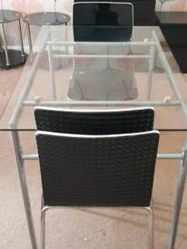 Glass Table and 4 Black Chairs