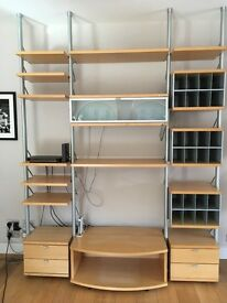 Hulsta wall shelving unit. German quality, design and flexibility-configurable in many permutations.