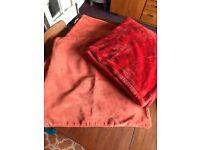 Burnt orange Matalan large cushion covers and throw