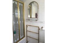 Gold plated effect bathroom fittings.