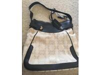 Coccinelle ladies cream and black handbag