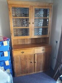 Beautiful antique wooden dresser with leaded glass doors