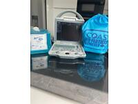 Ultrasound Scanner and Microchip Implanter