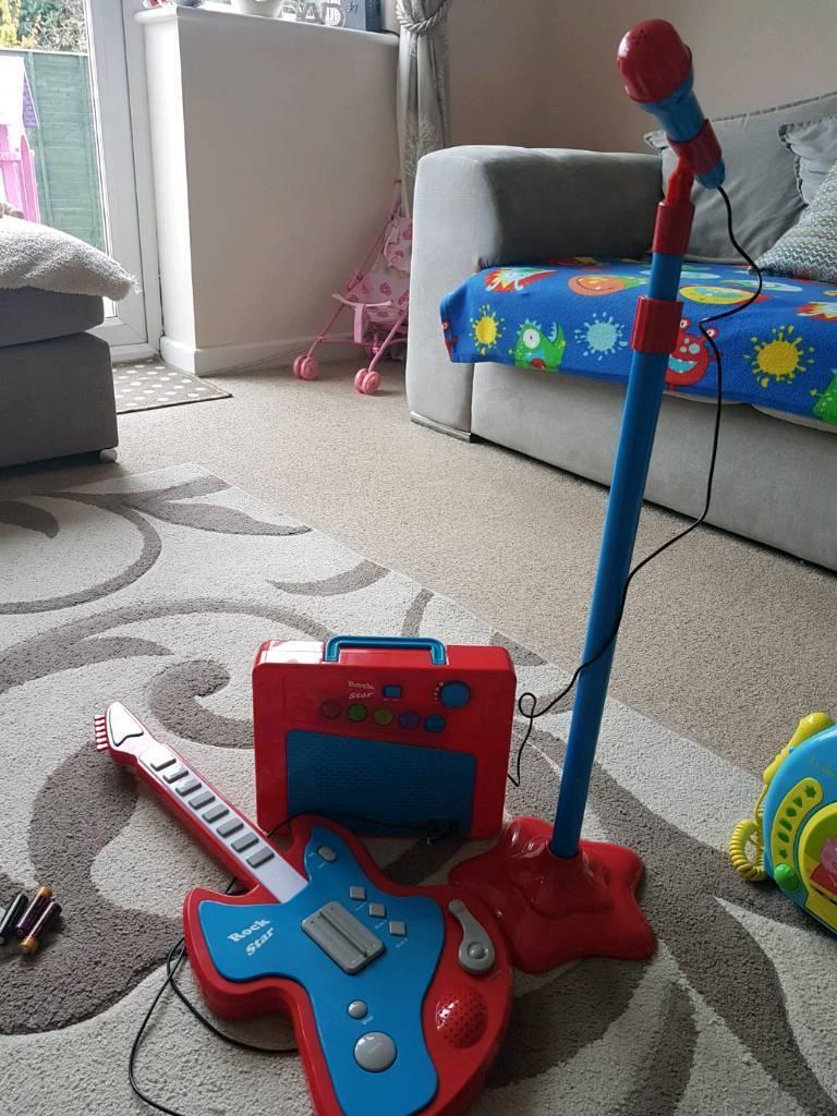 Rockstar amp, guitar and microphone