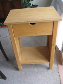 Wooden Side Table on castors with a drawer.