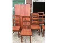 Solid Indian wood dining table and 6 chairs