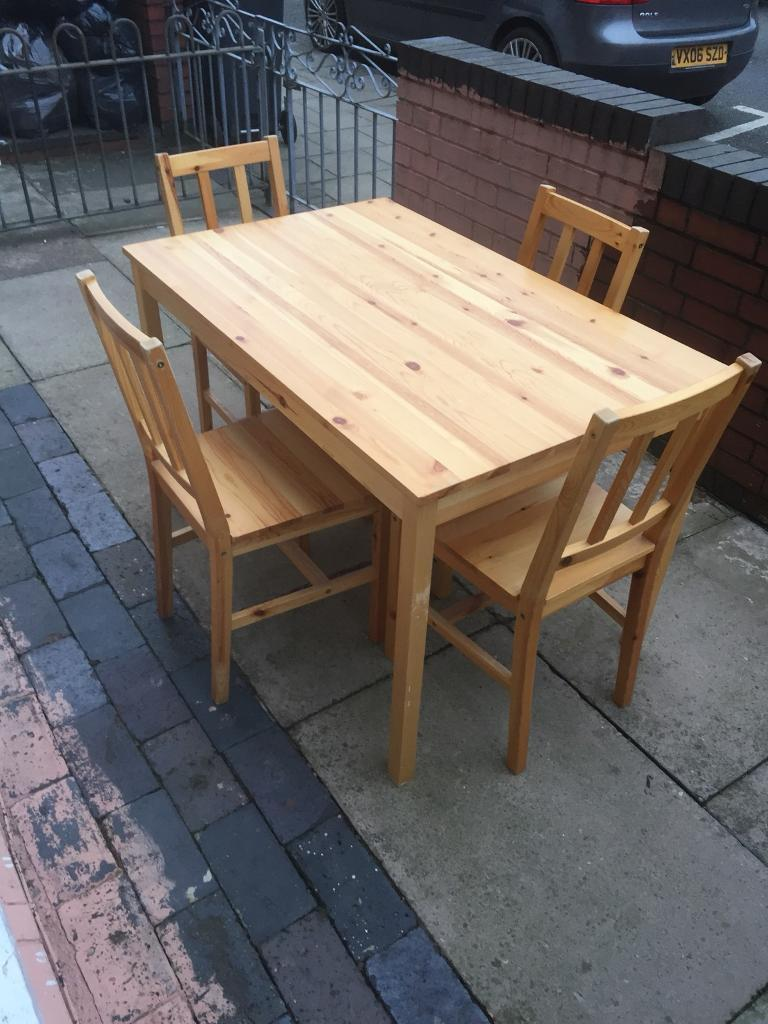 Lovely solid space saver pine dining table with 4 chair good condition