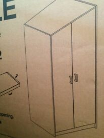 Brand new white wardrobes in packaging