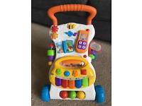 Baby walker toy with musical keyboard