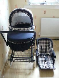 Boxed blue and white pram 3 in 1 carrycot, pram and pushchair, pushchair never used with rain cover