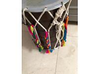 Dhol medium size with drum stick.