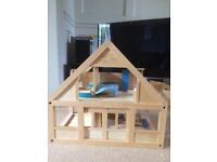 Wooden dolls house (Plan Toy)
