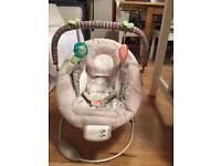 Nearly new Comfort and Harmony vibrating bouncer