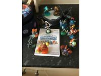 Sky landers wii game, portal , case and 13 skylanders