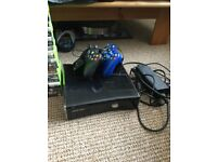 Xbox 360 console, 2 controllers, charging stand, selection of games