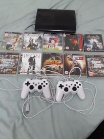 PS3 SLIM WITH 10 GMAES AND 2 CONTROLLER