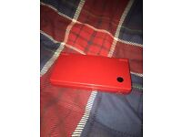 Red Nintendo DSI with front and back camera