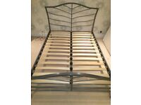 Double metal slatted bedframe and Miracoil mattress