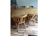 Pine farmhouse table and 5 fiddle back chairs