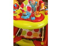 Walker and rocker, removeable play tray. Good condition