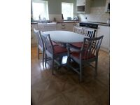 Grey painted Stag extendable table and six chairs