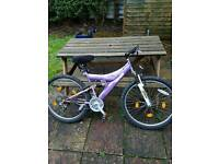 Mountain bicycle, pump and helmet