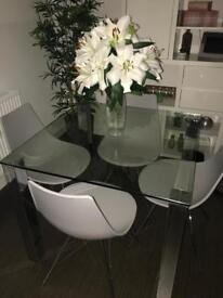 Glass table for sale (chairs not included)