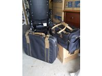 M&S Black and tan suitcase with keys