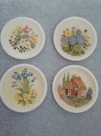 4 hand painted wall plates with 3D designs