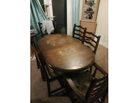 6 seater dining room table with chairs.