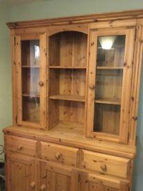 Pine wood dresser, height 198cm, width 132cm, depth 40cm.