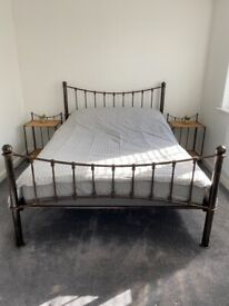 Double vintage bed frame and twin wicker bedside tables