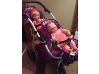 Like new toy twin buggy with two dolls.