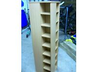 Rotating storage unit with removable shelves