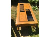 Solid wood coffee table with glass inlets