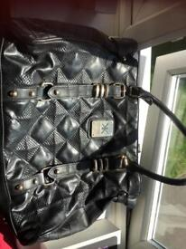 Kardashian black hand bag