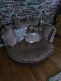 Brown swivel sofa chair