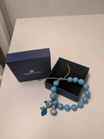 Swarowski blue pearl bracelet including 2 charms