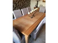 8 seat solid oak dining table