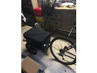 Bicycle trailer with pneumatic tyres and cover - quick release system.