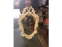 White intricate mirror