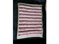 Baby blanket hand knitted.