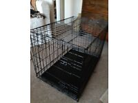 Metal dog crate for small dog.