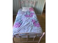 Pink single bed inc mattress and bedding