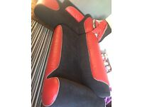 Red and black leather and material corner sofa