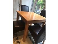 Wooden extendable dining table and chairs