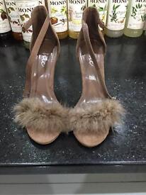 Brown far from high heels